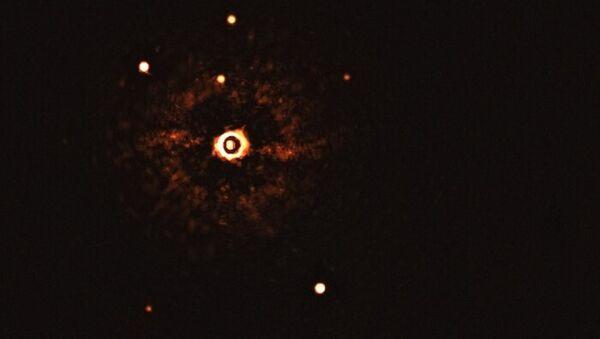 İlk kez bir başka güneş sisteminin yıldızı ve iki gezegeni, teleskopla gözlendi - Sputnik Türkiye