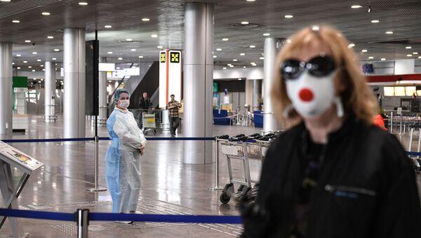 Rus turist, koronavirüs, Şeremetyevo Uluslararası Havalimanı  - Sputnik Türkiye