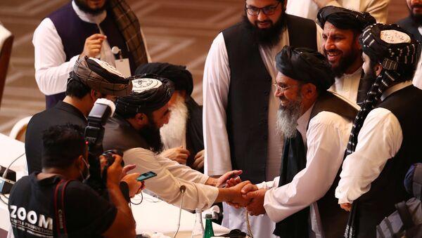 Afgan hükümeti ile Taliban arasındaki ilk doğrudan barış müzakereleri Katar'ın başkenti Doha'da başladı. - Sputnik Türkiye