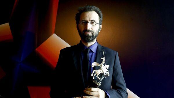 Senaristliğini ve yönetmenliğini Erdem Tepegöz'ün (fotoğrafta) üstlendiği Gölgeler İçinde filmi, 42. Moskova Film Festivali'nde Jüri Özel Ödülünü kazandı. - Sputnik Türkiye