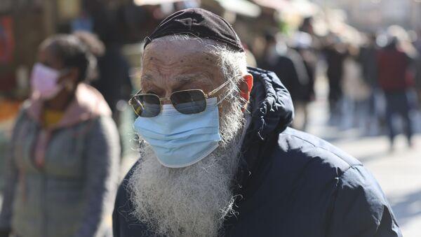 İsrail'de Ultra Ortodoks Yahudiler için maske ayarı - Sputnik Türkiye