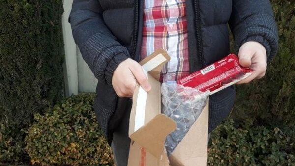 İnternetten telefon sipariş verdi, kargodan bisküvi çıktı - Sputnik Türkiye