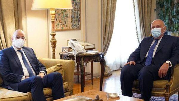 Mısır-Türkiye ilişkilerindeki ılımlı gelişmelerin ardından Yunan bakan Kahire'ye gitti - Sputnik Türkiye