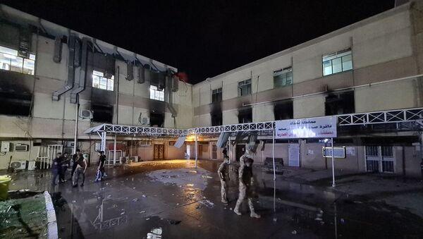 Irak'ın başkenti Bağdat'ta yeni tip koronavirüs (Kovid-19) hastalarının tedavi gördüğü Ebu el-Hatip Hastanesi'nde çıkan yangında 40 kişinin hayatını kaybettiği bildirildi. - Sputnik Türkiye