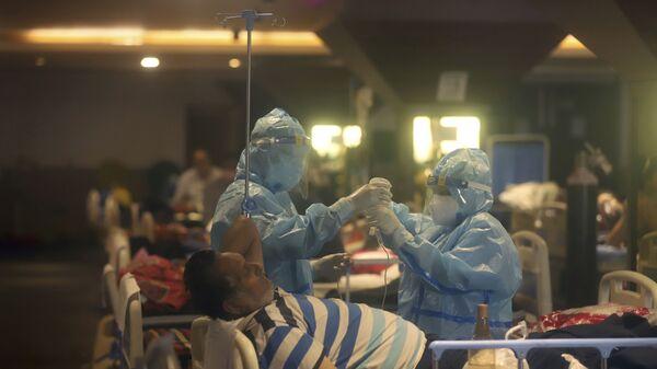 Hindistan'da koronavirüs kaynaklı ölümlerde yeni rekor - Sputnik Türkiye