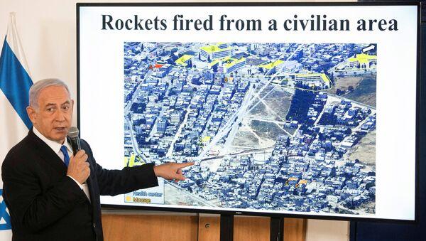 Gazze'deki Hamas ile İsrail arasında 10 Mayıs'ta başlayan savaşta 21 Mayıs'ta ateşkese girilmesinin ardından basın toplantısı düzenleyen İsrail Başbakanı Benyamin Netanyahu - Sputnik Türkiye