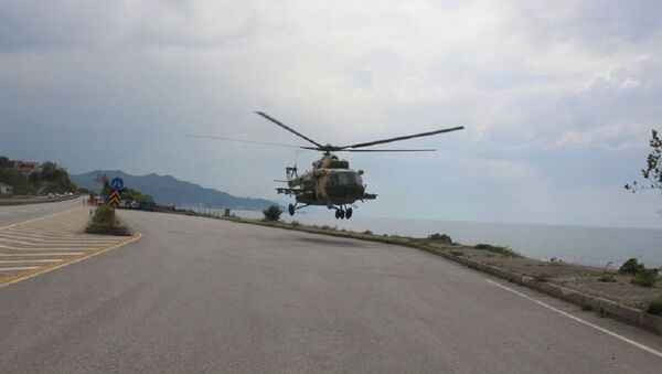 Sahile zorunlu iniş yapan Azerbaycan'ın askeri helikopteri bölgeden ayrıldı - Sputnik Türkiye