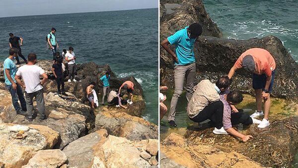 Bartın'ın Amasra ilçesinde kayalıkların üzerinde selfie çekerken denize düşen üniversite öğrencisi Ürdün uyruklu Seif Mohammad Yousef Khashan, vatandaşlar tarafından kurtarıldı. - Sputnik Türkiye