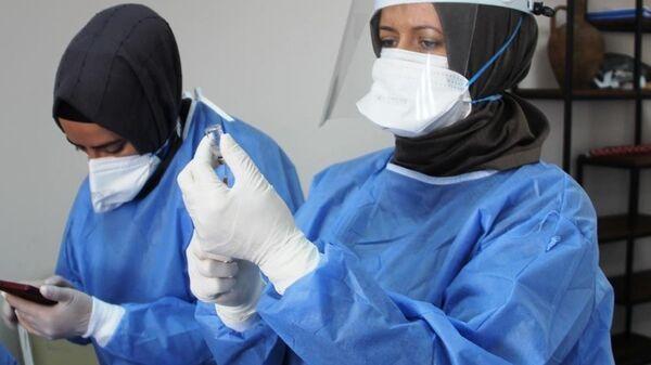 sağlık çalışanı - maske - koronavirüs - aşı - Sputnik Türkiye