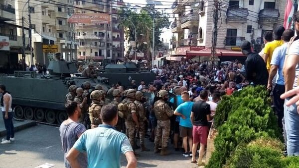 Lübnan'da Saad Hariri'nin hükümeti kurmayacağını açıklamasının ardından başlayan gösteriler devam ederken, Trablusşam kentinde çıkan çatışmada 25 kişi yaralandı. - Sputnik Türkiye