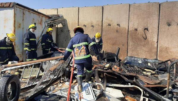 Irak'ın başkenti Bağdat'taki bir askeri havalimanında çıkan yangın büyük bir felakete yol açmadan kontrol altına alındı. - Sputnik Türkiye