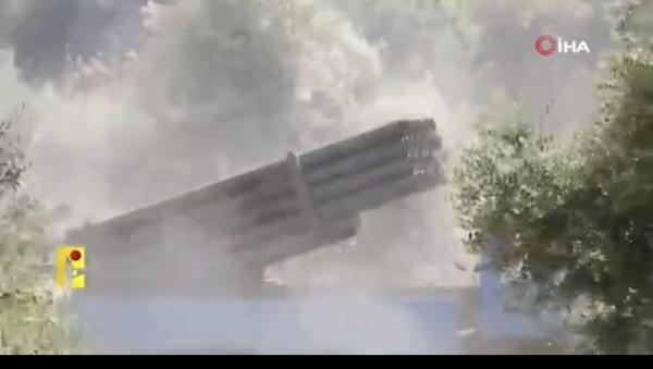 Lübnan'da Hizbullah, bugün İsrail'e düzenlediği füze saldırısına ait görüntüleri yayınladı. - Sputnik Türkiye