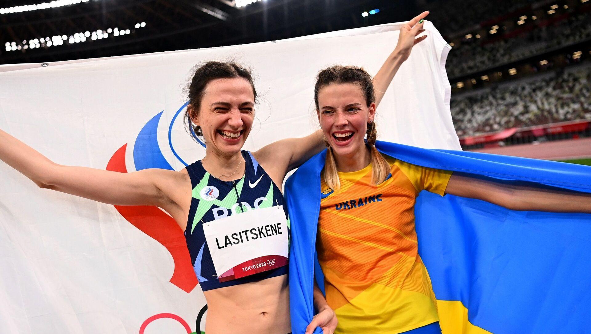 Rus sporcu Mariya Lasitskene - Ukraynalı atlet Yaroslava Maguçih - Sputnik Türkiye, 1920, 08.08.2021