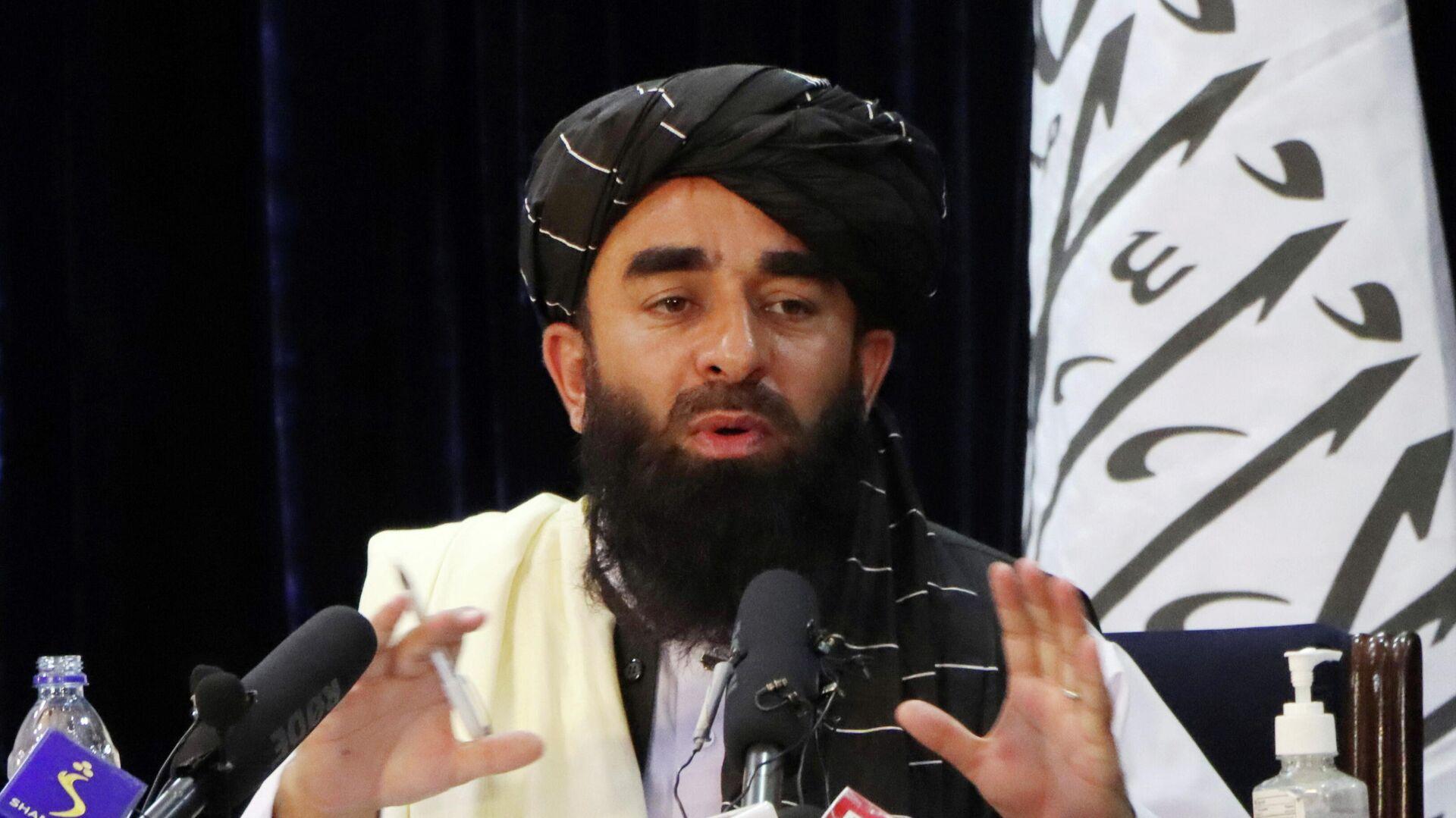 Taliban Sözcüsü Zabihullah Mücahid, Kabil'de basın toplantısı düzenlerken (Ağustos 2021) - Sputnik Türkiye, 1920, 23.09.2021