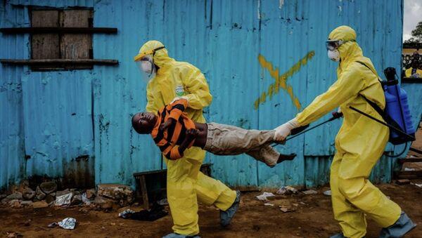 Daniel Berehulak, Ebola salgınında Liberya'da çektiği fotoğrafla Pulitzer kazandı. - Sputnik Türkiye