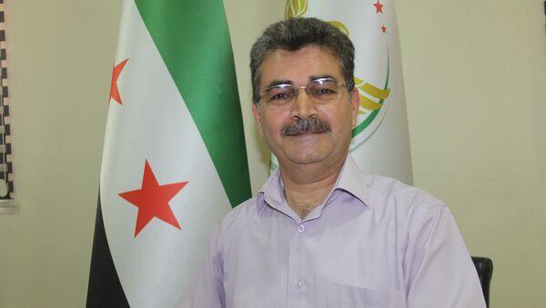 Suriye geçici hükümetinin Sağlık Bakanı Muhammed Vecih Cuma - Sputnik Türkiye