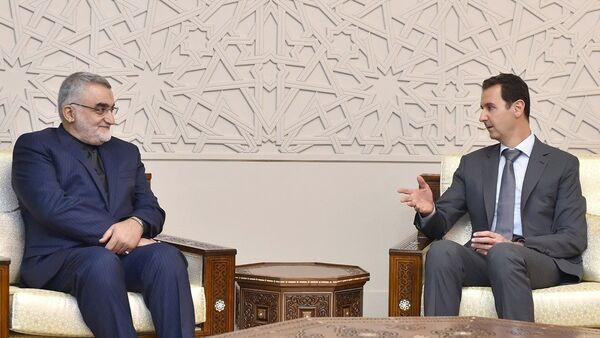 İran Meclisi Ulusal Güvenlik ve Dış Politika Komisyonu Başkanı Alaaddin Burucerdi, Şam'da Suriye Devlet Başkanı Beşar Esad'la görüştü. - Sputnik Türkiye