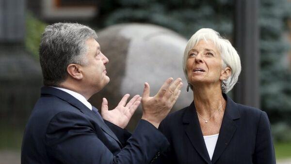 Ukrayna Devlet Başkanı Pyotr Poroşenko -  IMF Başkanı Christine Lagarde - Sputnik Türkiye