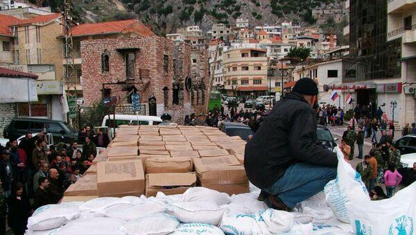 Rusya'dan Suriye'de Türkmenlerin yaşadığı Burj İslam kasabasına insani yardım - Sputnik Türkiye