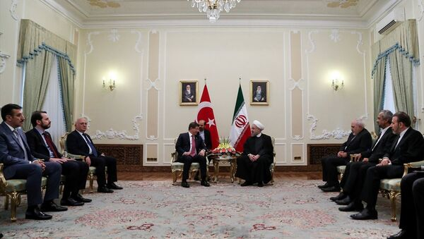 Türkiye Başbakanı Ahmet Davutoğlu- İran Cumhurbaşkanı Hasan Ruhani - Sputnik Türkiye