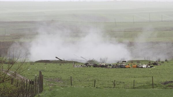 An Armenian artillery unit is seen in the town of Martakert, where clashes with Azeri forces are taking place, in Nagorno-Karabakh region, which is controlled by separatist Armenians, April 3, 2016. - Sputnik Türkiye