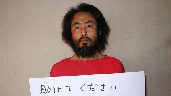 Suriye'de geçen sene kaybolan ve El Nusra tarafından kaçırıldığı düşünülen Japon gazeteci Jumpei Yasuda - Sputnik Türkiye