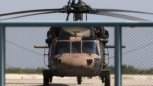Darbe girişiminin başarısız olmasının ardından Yunanistan'ın Dedeağaç kentine kaçan askerlerin kullandığı helikopter - Sputnik Türkiye