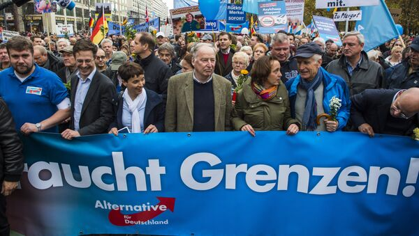 Frauke Petry (3rd, L), chairman of the right-wing populist Alternative for Germany (AfD) party, and the AfD's leading politician Alexander Gauland (4th, L) hold a banner reading Asylum needs limits during a demonstration against the German government's asylum policy organized by the AfD party in Berlin on November 7, 2015. - Sputnik Türkiye
