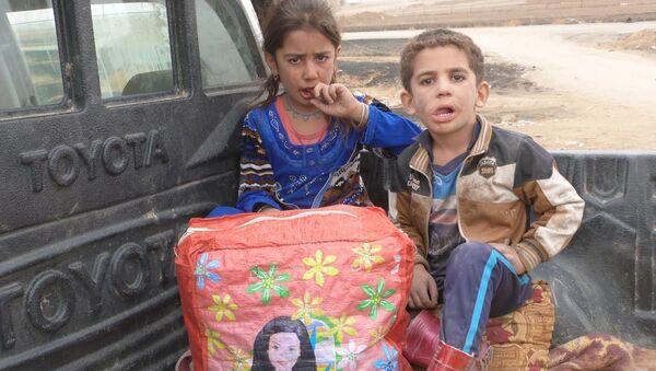 Musul'da evleri koasliyon uçakları tarafından bombalanan Esma ve Yusuf kardeşler - Sputnik Türkiye