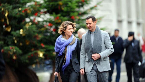 Suriye Devlet Başkanı Beşar Esad, eşi Esma ile birlikte Paris'te. - Sputnik Türkiye