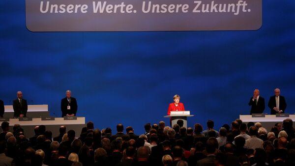 Almanya Başbakanı Angela Merkel, Hristiyan Demokrat Birlik Partisi'nin (CDU) 29. Olağan Genel Kongresi'nde yeniden genel başkanlığa seçildi. - Sputnik Türkiye