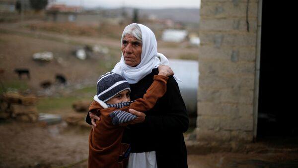 IŞİD'den geri alınan Ezidi çocuk ailesine kavuştu - Sputnik Türkiye
