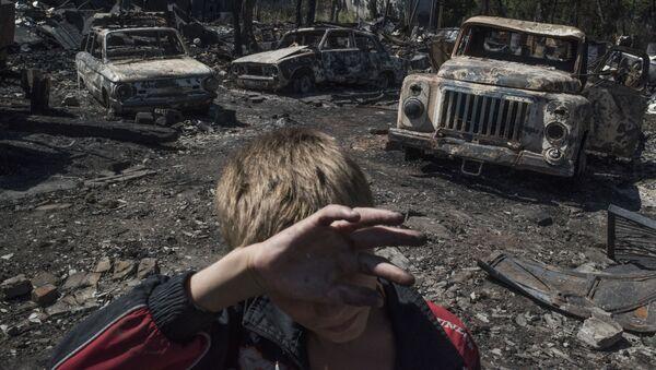 Donetsk bölgesinin Lozovoye kasabasına düzenlenen saldırının sonuçları. - Sputnik Türkiye