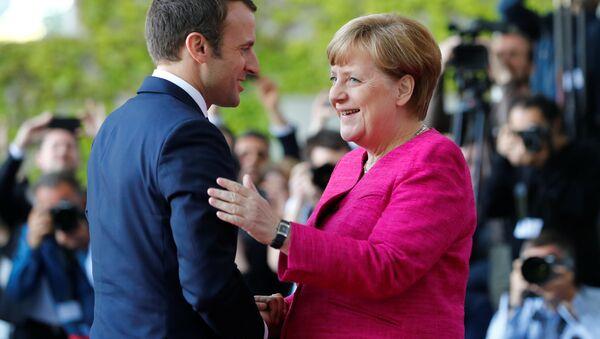 Fransa Cumhurbaşkanı Emmanuel Macron ve Almanya BaşbakanI Angela Merkel - Sputnik Türkiye