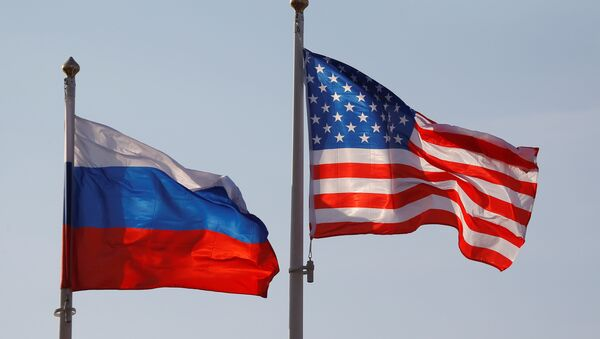National flags of Russia and the US fly at Vnukovo International Airport in Moscow, Russia April 11, 2017 - Sputnik Türkiye