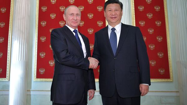 Rusya Devlet Başkanı Vladimir Putin ile Çinli mevkidaşı Şi Cinping - Sputnik Türkiye