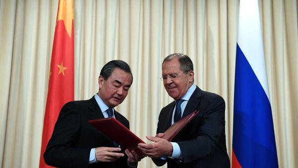 Rusya Dışişleri Bakanı Sergey Lavrov ve Çin Dışişleri Bakanı Wang Yi, - Sputnik Türkiye
