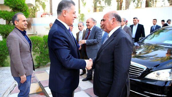 Irak Kürt Bölgesel Yönetimi (IKBY) Yüksek Referandum Heyeti, başkent Bağdat'ta Irak Türkmen Cephesi'ni (ITC) ziyaret ederek, referandumu ele aldı. Heyeti, ITC Başkanı Erşet Salihi (ortada) ve diğer parti yetkilileri Bağdat'taki parti merkezinde karşıladı. - Sputnik Türkiye