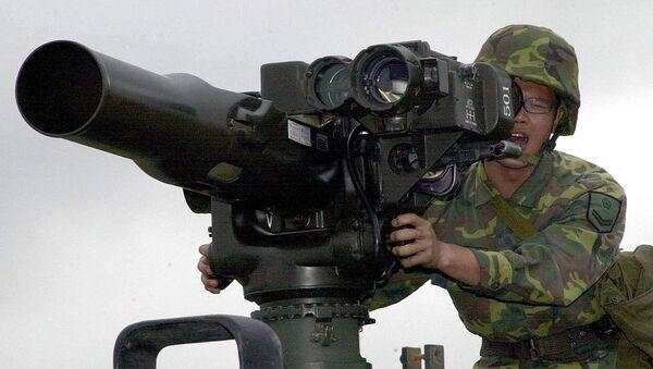 A military soldier operates a TOW anti-tank missile launcher. File photo - Sputnik Türkiye