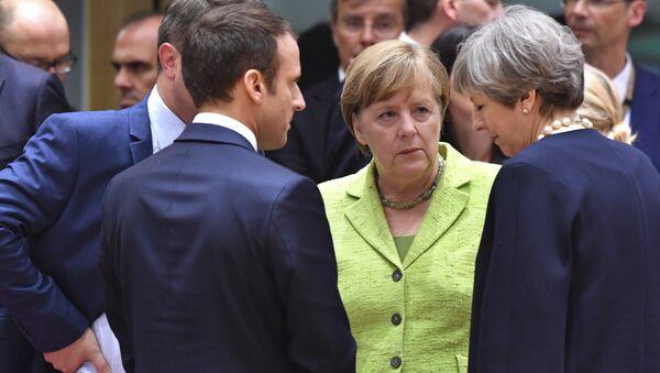 Fransa Cumhurbaşkanı Emmanuel Macron, Almanya Başbakanı Angela Merkel, İngiltere Başbakanı Theresa May - Sputnik Türkiye