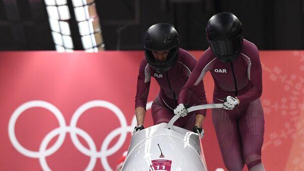Rus bobsledçiler Anastasiya Koçerjova ve Nadejda Sergeyeva - Sputnik Türkiye