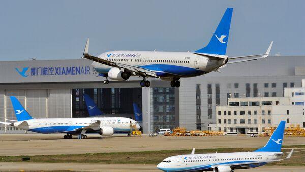 Çin, Fujian eyaleti, Fuzhou Havaalanı, Xiamen Havayolları, Boeing 737-800 uçağı - Sputnik Türkiye