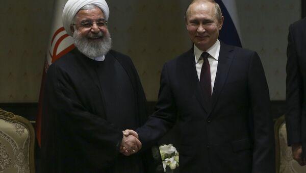 Rusya Devlet Başkanı Vladimir Putin, İran Cumhurbaşkanı Hasan Ruhani ile Cumhurbaşkanlığı Külliyesi'nde başbaşa görüştü. - Sputnik Türkiye