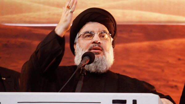 Lebanon's Hezbollah leader Sayyed Hassan Nasrallah addresses his supporters during a rare public appearance at an Ashoura ceremony in Beirut's southern suburbs November 3, 2014 - Sputnik Türkiye