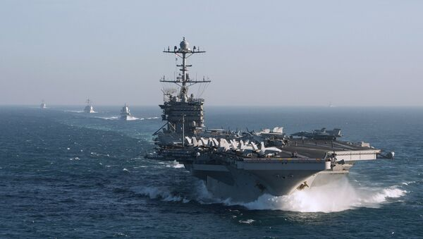 The aircraft carrier group of the United States Navy led by USS Harry S. Truman, front, and a ship escort are seen leaving the port of Norfolk heading for the Middle East - Sputnik Türkiye