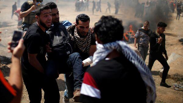 ABD Büyükelçiliği'nin Tel Aviv'den taşınarak İsrail'in kuruluşunun 70. yıldönümü olan bugün Kudüs'te açılmasına karşı Gazze'de protestolar, çatışmalar - Sputnik Türkiye