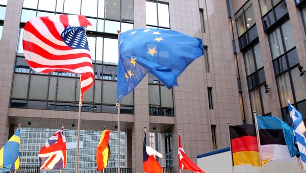 The US and EU flags, top left and right, fly in separate directions at the European Council building in Brussels - Sputnik Türkiye