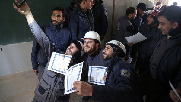 Members of the Syrian Civil Defence, known as the White Helmets, take a selfie with their certificates after taking part in a training session in the rebel-held eastern Ghouta area, east of the capital Damascus, on November 22, 2016 - Sputnik Türkiye