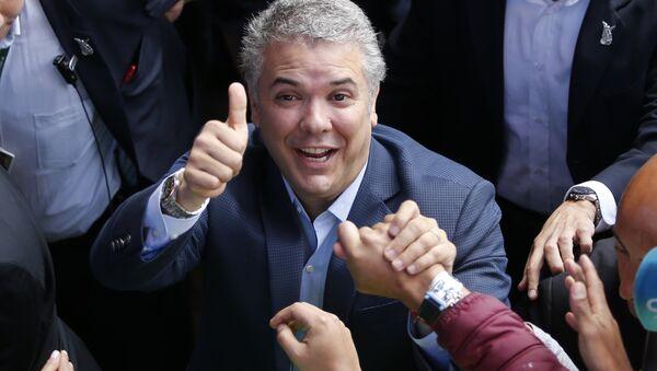 Demokratik Merkez Parti adayı Ivan Duque Kolombiya Devlet Başkanlığı seçimini kazandı - Sputnik Türkiye