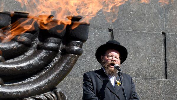 1942'de yüz binlerce Yahudi'nin toplama kamplarına götürüldüğü Varşova'daki Yahudi gettosunda 1943'te çıkan ayaklanma çok kanlı şekilde bastırılmıştı. 19 Nisan 2018'deki 75. yıldönümünde Getto Kahramanları Anıtı'nda tören düzenlendi. - Sputnik Türkiye